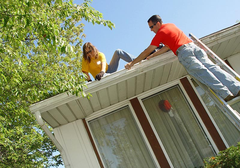 Unfastened Gutters Being Worked On